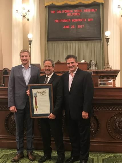 Photo of Bobby Ralston, Chair, Board of Directors and Richard Ayoub, Executive Director, Project Angel Food with Assemblymember Richard Bloom.