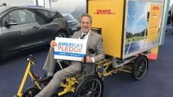 Assemblymember Bloom posing on a DHL delivery bike
