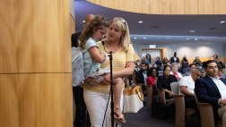 Child held by mother, testifying