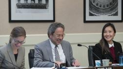 Assemblymember Bloom shares laugh with committee staff
