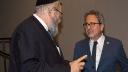 Asm. Bloom speaking with rabbi