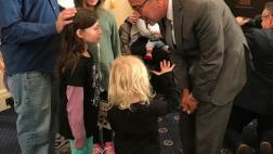 Asm. Bloom interacts with child
